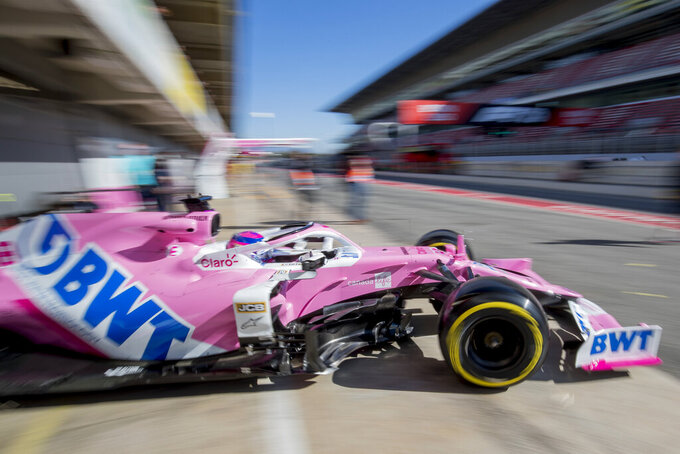 Racing Point driver Lance Stroll of Canada drives out of his team's pit garage during the Formula One pre-season testing session at the Barcelona Catalunya racetrack in Montmelo, outside Barcelona, Spain, Wednesday, Feb. 26, 2020. (AP Photo/Joan Monfort)