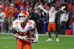 Clemson safety Nolan Turner (24) celebrates after his interception against Ohio State during the final minute of the Fiesta Bowl NCAA college football playoff semifinal Saturday, Dec. 28, 2019, in Glendale, Ariz. (AP Photo/Rick Scuteri)