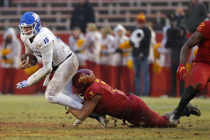 Drake quarterback Grant Kraemer (15) is sacked by Iowa State defensive end JaQuan Bailey (3) during the second half of an NCAA college football game, Saturday, Dec. 1, 2018, in Ames, Iowa. (AP Photo/Charlie Neibergall)
