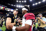 New Orleans Saints quarterback Drew Brees (9) greets Arizona Cardinals quarterback Kyler Murray after their NFL football game in New Orleans, Sunday, Oct. 27, 2019. The Saints won 31-9. (AP Photo/Bill Feig)