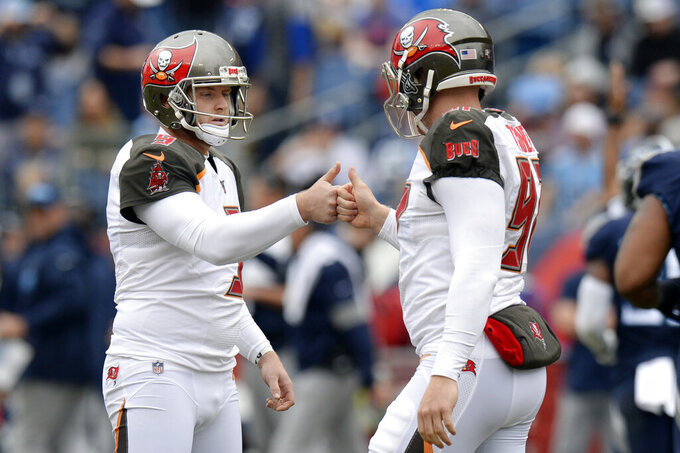 Tampa Bay Buccaneers kicker Matt Gay (9) is congratulated by long snapper Zach Triner (97) after Gay kicked a 48-yard field goal against the Tennessee Titans in the first half of an NFL football game Sunday, Oct. 27, 2019, in Nashville, Tenn. (AP Photo/Mark Zaleski)