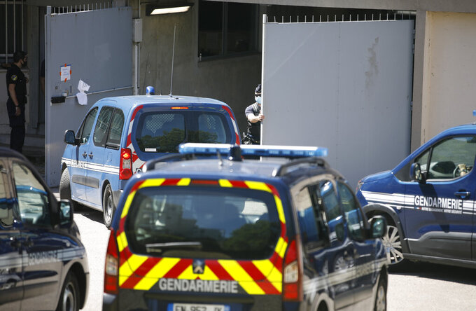 A police convoy carrying a Frenchman accused of inspiring the kidnapping of a young girl arrives at the hall of justice in Nancy, eastern France, Wednesday June 16, 2021. France had issued an Interpol arrest notice for Remy Daillet-Wiedemann, who was detained on immigration charges by Malaysia. Prosecutors accuse Daillet-Wiedemann of helping organize the abduction of an 8-year-old girl in eastern France on behalf of her mother, who had lost custody of the child. (AP Photo/Jean-Francois Badias)