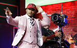 Oklahoma quarterback Kyler Murray waves after the Arizona Cardinals selected Murray in the first round at the NFL football draft, Thursday, April 25, 2019, in Nashville, Tenn. (AP Photo/Mark Humphrey)