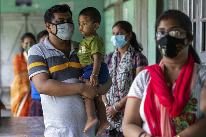 People above eighteen years age queue up to get vaccinated against the coronavirus in Gauhati, Assam, India, Monday, May 10, 2021. (AP Photo/Anupam Nath)