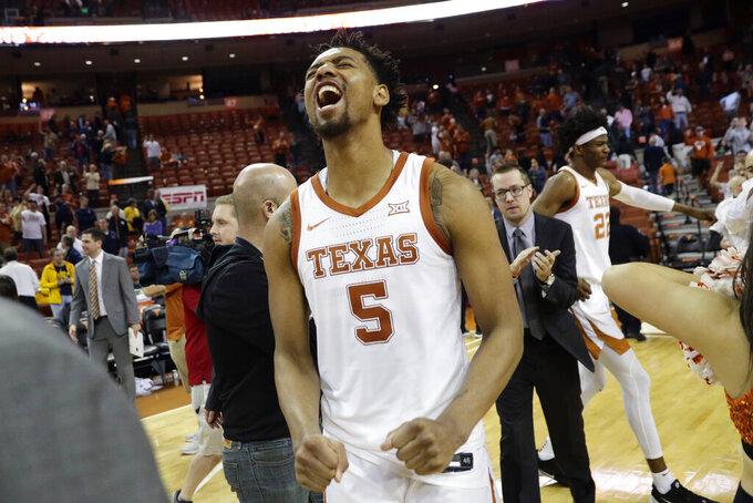 Texas forward Royce Hamm Jr. (5) celebrates the team's win over West Virginia in an NCAA college basketball game, Monday, Feb. 24, 2020, in Austin, Texas. (AP Photo/Eric Gay)