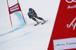 New Zealand's Alice Robinson speeds down the course during an alpine ski, women's World Cup giant slalom, in Lenzerheide, Switzerland, Sunday, March 21, 2021. (AP Photo/Gabriele Facciotti)
