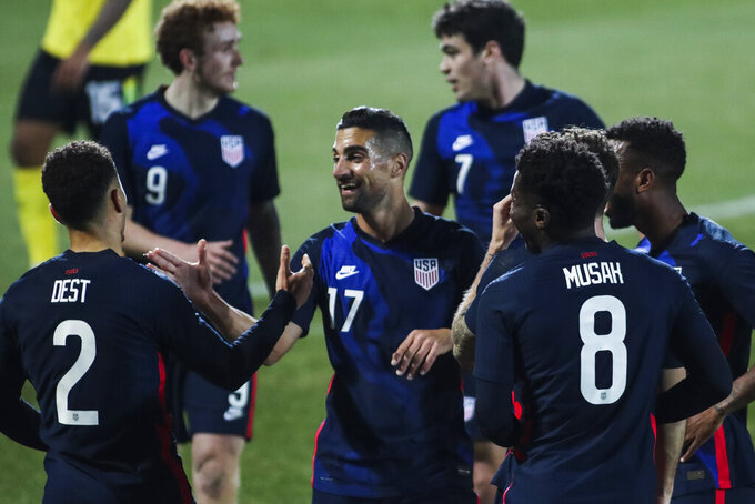 US players celebrate after scoring the opening goal during the international friendly soccer match between USA and Jamaica at SC Wiener Neustadt stadium in Wiener Neustadt, Austria, Thursday, March 25, 2021. (AP Photo/Ronald Zak)