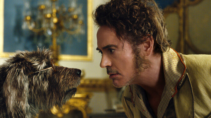 This image released by Universal Pictures shows Dr. John Dolittle, portrayed by Robert Downey Jr., right, with Jip, voiced by Tom Holland, in a scene from