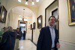 FILE - In this Tuesday, Nov. 12, 2019, file photo, Democratic presidential candidate Montana Gov. Steve Bullock walks through a hallway at the State House, in Concord, N.H. after filing to be placed on the New Hampshire primary ballot. The quadrennial chaos has quieted down over at the New Hampshire secretary of state's office with the closing of the filing period for the first-in-the-nation presidential primary. (AP Photo/Elise Amendola, File)