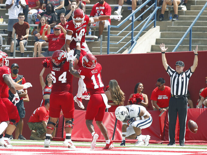 Fresno State wide receiver Ty Jones (8)  celebrates a touchdown against Connecticut during the first half of an NCAA college football game in Fresno, Calif., Saturday, Aug. 28, 2021. (AP Photo/Gary Kazanjian)