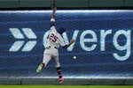 St. Louis Cardinals right fielder Dexter Fowler can't catch a fly ball by Kansas City Royals' Adalberto Mondesi that went for a triple during the first inning of a baseball game Tuesday, Sept. 22, 2020, in Kansas City, Mo. (AP Photo/Charlie Riedel)