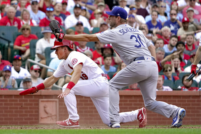 St. Louis Cardinals' Tommy Edman (19) scores past Los Angeles Dodgers starting pitcher Max Scherzer (31) on a passed ball during the sixth inning of a baseball game Monday, Sept. 6, 2021, in St. Louis. (AP Photo/Jeff Roberson)