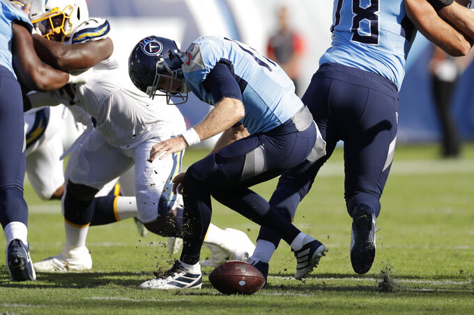 Tennessee Titans quarterback Ryan Tannehill recovers a loose ball in the first half of an NFL football game against the Los Angeles Chargers Sunday, Oct. 20, 2019, in Nashville, Tenn. (AP Photo/James Kenney)