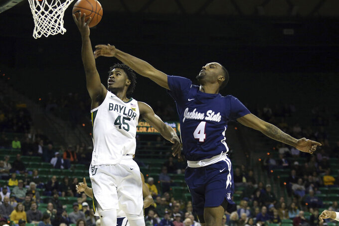 Baylor guard Davion Mitchell (45) attempts a shot past Jackson State guard Tristan Jarrett (4) in the first half of an NCAA college basketball game, Monday, Dec. 30, 2019, in Waco, Texas. (AP Photo/Jerry Larson)