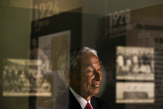"In this July 8, 2019, photo, Kazuo Oda, a son of Mikio Oda, who won Japan's first Olympic gold medal and Asia's first individual gold medal at the 1928 Amsterdam Olympics, smiles during an interview with The Associated Press at Edo-Tokyo Museum in Tokyo. ""My father was from Hiroshima, so there was a celebration in his hometown upon his return,"" Kazuo Oda said. ""But as there were no media possibilities like today, his achievements were not known by everybody in Japan."" (AP Photo/Jae C. Hong)"