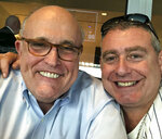 This undated image released by the House Judiciary Committee from documents provided by Lev Parnas to the committee in the impeachment probe against President Donald Trump, shows a photo of Lev Parnas with Rudy Giuliani. Parnas, a close associate of Trump's personal lawyer Giuliani is claiming Trump was directly involved in the effort to pressure Ukraine to investigate Democratic rival Joe Biden. Trump on Thursday, Jan. 16, 2020, repeated denials that he is acquainted with Parnas, despite numerous photos that have emerged of the two men together.(House Judiciary Committee via AP)