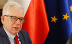 Poland's Foreign Minister Jacek Czaputowicz says that President Andrzej Duda will discuss boosting the U.S. military presence in Poland and greater U.S. economic involvement when he is hosted by President Donald Trump at the White House next week, during an interview for the Associated Press in Warsaw, Poland, Friday, Sept. 14, 2018. (AP Photo/Czarek Sokolowski)