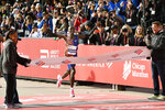 Lawrence Cherono, of Kenya, wins the men's race in the Chicago Marathon Sunday, Oct. 13, 2019. (AP Photo/Paul Beaty)