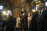 U.S. Secretary of State Antony Blinken, centre, accompanied by the Head of the Independent Ukrainian Church Metropolitan Epiphanius, left, visit the Mikhailovsky Zlatoverkhy Cathedral (St. Michael's Golden-Domed Cathedral) in Kyiv, Ukraine, Thursday, May 6, 2021.  Blinken is in Kyiv on Thursday, meeting top Ukrainian officials during a one-day visit that is highly anticipated in the country as it faces heightened tensions with Russia. (AP Photo/Efrem Lukatsky, Pool)