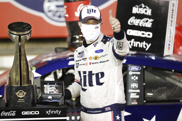 Brad Keselowski celebrates after winning the NASCAR Cup Series auto race at Charlotte Motor Speedway early Monday, May 25, 2020, in Concord, N.C. (AP Photo/Gerry Broome)