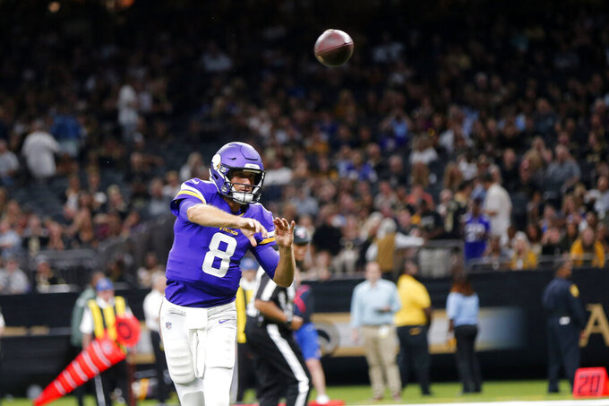 Minnesota Vikings quarterback Kirk Cousins (8) throws a touchdown pass in the first half of an NFL preseason football game against the New Orleans Saints in New Orleans, Friday, Aug. 9, 2019. (AP Photo/Gerald Herbert)