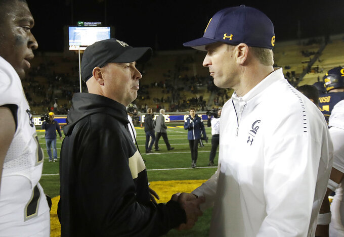 Colorado interim head coach Kurt Roper, left, shakes hands with California head coach Justin Wilcox after an NCAA college football game in Berkeley, Calif., Saturday, Nov. 24, 2018. California won, 33-21. (AP Photo/Jeff Chiu)