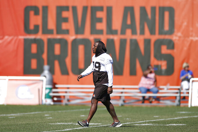 FILE - In this Aug. 5, 2019, file photo, Cleveland Browns running back Duke Johnson (29) walks onto the field during practice at the NFL football team's training facility in Berea, Ohio. The Browns have traded disgruntled running back Duke Johnson, Thursday, Aug. 8, 2019,  to the Houston Texans for an undisclosed 2020 draft pick. (AP Photo/Ron Schwane, File)