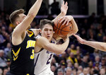 Northwestern guard Ryan Greer, center, drives to the basket against Iowa guard Jordan Bohannon, left, and forward Nicholas Baer during the second half of an NCAA college basketball game Wednesday, Jan. 9, 2019, in Evanston, Ill. Iowa won 73-63. (AP Photo/Nam Y. Huh)