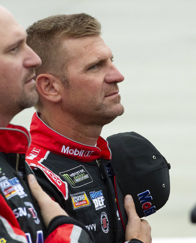 NASCAR driver Clint Bowyer stands during the National Anthem before a NASCAR Cup series auto race at Dover International Speedway in Dover, Del., Sunday, May 5, 2019.  The race was postponed until Monday due to inclement weather. (AP Photo/Jason Minto)