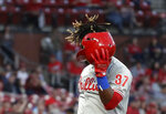 Philadelphia Phillies' Odubel Herrera loses his helmet after striking out to end the top of the second inning of a baseball game against the St. Louis Cardinals, Monday, May 6, 2019, in St. Louis. (AP Photo/Jeff Roberson)