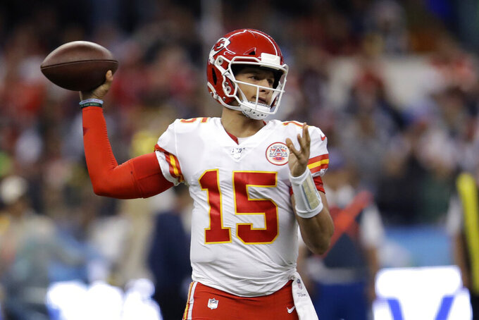Kansas City Chiefs quarterback Patrick Mahomes throws a pass during the first half of an NFL football game against the Los Angeles Chargers, Monday, Nov. 18, 2019, in Mexico City. (AP Photo/Marcio Jose Sanchez)