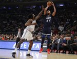 Minnesota Timberwolves' Taj Gibson (67) shoots over New York Knicks' DeAndre Jordan (6) during the first half of an NBA basketball game Friday, Feb. 22, 2019, in New York. The Timberwolves won 115-104. (AP Photo/Frank Franklin II)