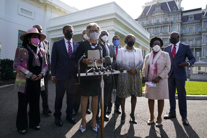 Rep. Joyce Beatty, D-Ohio, center, chair of the Congressional Black Caucus, speaks with members of the press alongside caucus members after meeting with President Joe Biden and Vice President Kamala Harris at the White House, Tuesday, April 13, 2021, in Washington. (AP Photo/Patrick Semansky)