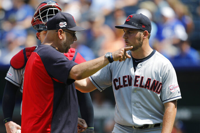 "FILE - In a Sunday, July 28, 2019 file photo, Cleveland Indians manager Terry Francona, left, has words with pitcherTrevor Bauer, right, as Bauer is taken out in the fifth inning of a baseball game against the Kansas City Royals at Kauffman Stadium in Kansas City, Mo. Francona said Sunday, July 5, 2020 that he believes the Indians need to change their name. ""I think it's time to move forward,"" Francona said Sunday. (AP Photo/Colin E. Braley, File)"