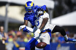 Los Angeles Rams cornerback Jalen Ramsey, front, breaks up a pass to wide receiver DeSean Jackson during an NFL football training camp practice in Irvine, Calif., Saturday, July 31, 2021. (AP Photo/Kelvin Kuo)