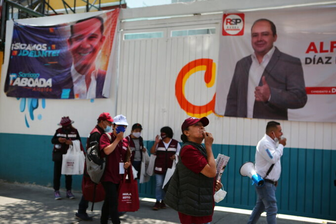 Supporters of the ruling party Morena mayoral candidate Paula Soto, take part in a campaign event leading up to the June 6 mid-term elections, in Mexico City, Saturday, May 29, 2021. (AP Photo/Ginnette Riquelme)