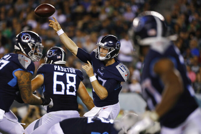 Tennessee Titans' Ryan Tannehill releases a pass during the first half of the team's preseason NFL football game against the Philadelphia Eagles, Thursday, Aug. 8, 2019, in Philadelphia. (AP Photo/Matt Rourke)