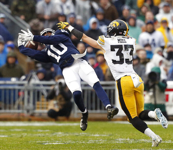 Penn State's Brandon Polk (10) cannot hang onto a long pass as Iowa's Riley Moss (33) defends during the first half of an NCAA college football game in State College, Pa., Saturday, Oct. 27, 2018. (AP Photo/Chris Knight)