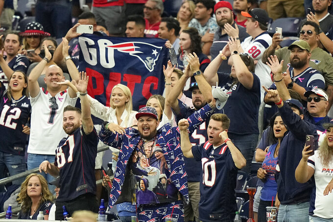 New England Patriots fans celebrate after an NFL football game against the Houston Texans Sunday, Oct. 10, 2021, in Houston. The Patriots won 25-22. (AP Photo/Eric Christian Smith)