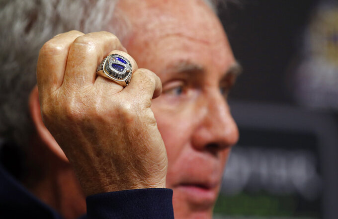 The ring on Hall of Fame driver and FOX television announcer Darrell Waltrip is seen as he speaks to the media during a press conference announcing his retirement from the booth before practice for a NASCAR Cup Series auto race, Friday, April 5, 2019, in Bristol, Tenn. (AP Photo/Wade Payne)