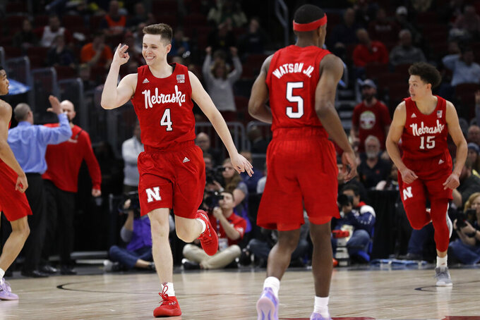 Nebraska's Johnny Trueblood (4) celebrates after making a 3-point basket during the second half of an NCAA college basketball game against the Maryland in the second round of the Big Ten Conference tournament, Thursday, March 14, 2019, in Chicago. The Nebraska won 69-61. (AP Photo/Nam Y. Huh)