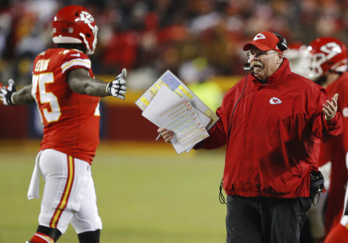 Kansas City Chiefs head coach Andy Reid argues a call during the second half of the AFC Championship NFL football game against the New England Patriots, Sunday, Jan. 20, 2019, in Kansas City, Mo. (AP Photo/Charlie Neibergall)