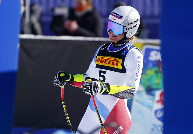 Switzerland's Corinne Suter smiles as she arrives at the finish area during the women's super-G, at the alpine ski World Championships in Cortina d'Ampezzo, Italy, Thursday, Feb. 11, 2021. (AP Photo/Giovanni Auletta)