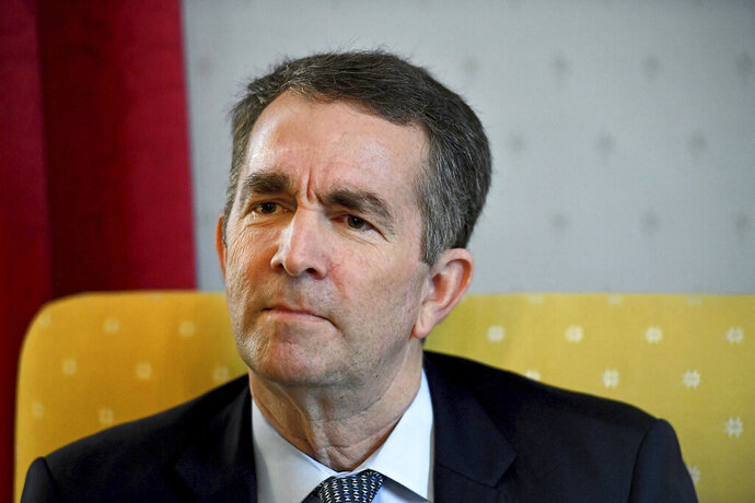 Virginia Gov. Ralph Northam talks during an interview at the Governor's Mansion, Saturday, Feb. 9, 2019 in Richmond, Va. The embattled governor says he wants to spend the remaining three years of his term pursuing racial