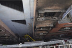 The walls of a building stand blackened after it caught fire in New Delhi, India, Sunday, Dec. 8, 2019. Dozens of people died on Sunday in a devastating fire at a building in a crowded grains market area in central New Delhi, police said. Firefighters fought the blaze from 100 meters (yards) away because it broke out in one of the area's many alleyways, tangled in electrical wire and too narrow for vehicles to access, authorities at the scene said. (AP Photo/Dinesh Joshi)
