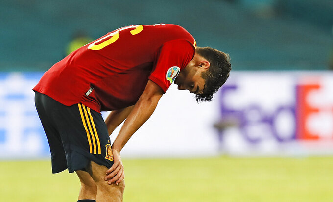 Spain's Pedri reacts disappointed after the Euro 2020 soccer championship group E match between Spain and Sweden in Sevilla, Spain, Monday, June 14, 2021. (Jose Manuel Vidal/Pool via AP)
