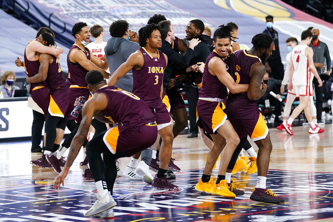 Iona players celebrate after winning an NCAA college basketball game against Fairfield during the finals of the Metro Atlantic Athletic Conference tournament, Saturday, March 13, 2021, in Atlantic City, N.J. (AP Photo/Matt Slocum)