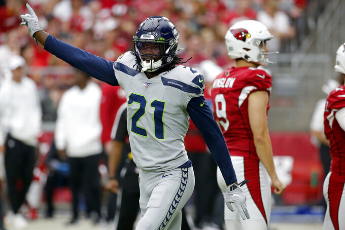 Seattle Seahawks cornerback Tre Flowers (21) celebrates after a missed field goal by the Arizona Cardinals during the first half of an NFL football game, Sunday, Sept. 29, 2019, in Glendale, Ariz. (AP Photo/Rick Scuteri)