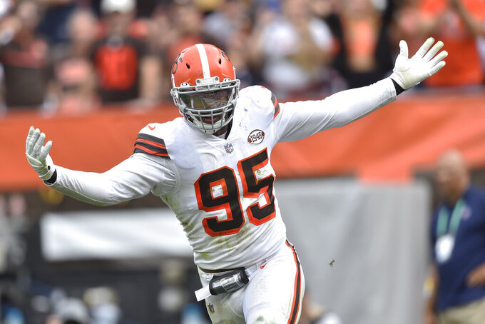 Cleveland Browns defensive end Myles Garrett celebrates after sacking Chicago Bears quarterback Justin Fields during the second half of an NFL football game, Sunday, Sept. 26, 2021, in Cleveland. (AP Photo/David Richard)