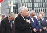 Poland's ruling party leader Jaroslaw Kaczynski, center, during a police-guarded ceremony in Warsaw, Poland, Friday, July 10, 2020 remembering his twin brother, the late president Lech Kaczynski and 95 others, killed in a plane crash in Russia in the year 2010. Friday was the last day of campaigning in Poland's presidential election runoff in which incumbent president, Andrzej Duda enjoys the right-wing ruling party's backing for a reelection, rivalling liberal Warsaw mayor, Rafal Trzaskowski. Opinion polls suggest the election may be decided by a small number of votes. (AP Photo/Czarek Sokolowski)